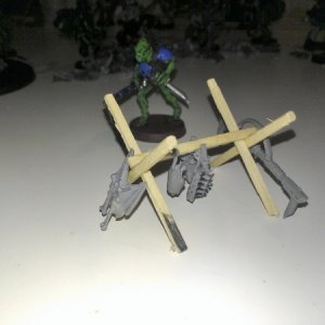 Encampment I'm working on for my old Kroot.  Made with matchsticks and Kroot bits.