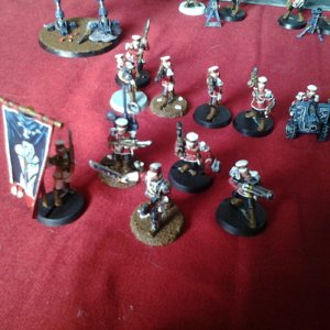 HQ of Vaughton 1sr regiment. Converted standard, medic and vox. Imperial guard (colonal schafeur model used for captain)